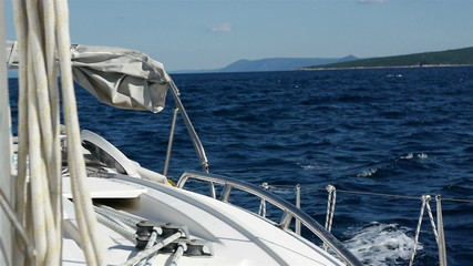 Sailing with sailboat at blue sea