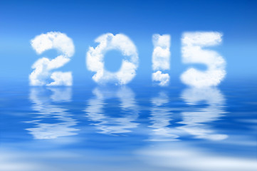 2015 written with clouds, water reflection