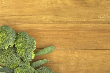 Broccoli on golden teak wood background