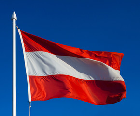 Flag of Austria against blue sky