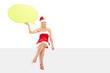 Female in Santa costume holding a speech bubble