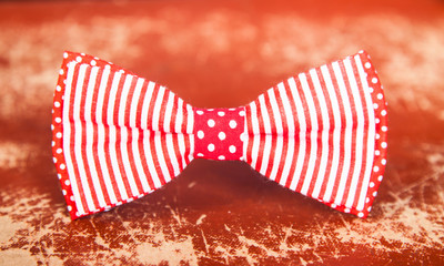 red bow tie with stripes and polka dots