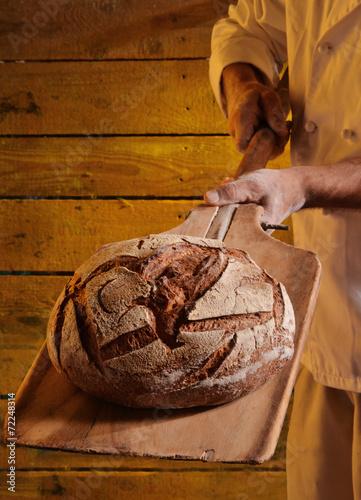 Fotobehang Brood Panadero horneando pan.
