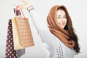 playful cute winter girl with shopping bags