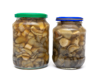 marinated mushrooms in the glass jars isolated on white backgrou