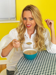 Attractive Young Woman Eating Soup