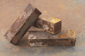 Macro of three rusty iron bar stack over each other