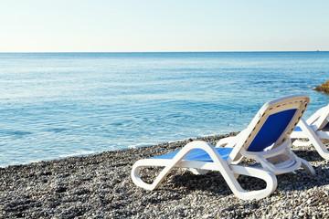 chairs on urban Massandra pebble beach in Yalta