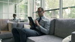 Businessman working on tablet and sitting on the sofa