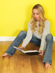 Attractive Young Woman Reading a Book