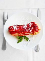 dessert eclair on white plate