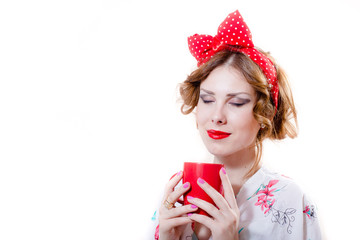 Funny pinup woman drinking hot tea or coffee