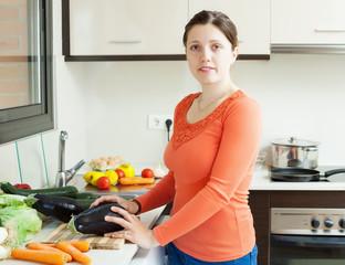 woman cooking eggplants