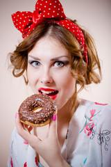 pinup girl having fun eating donut