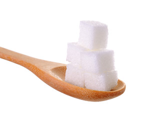 cube sugars in wooden spoon isolated on white background