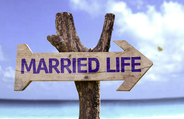 Married Life wooden sign with a beach on background