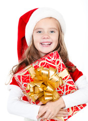 Happy cute little girl with christmas gift box