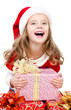 Happy cute little girl with christmas gift