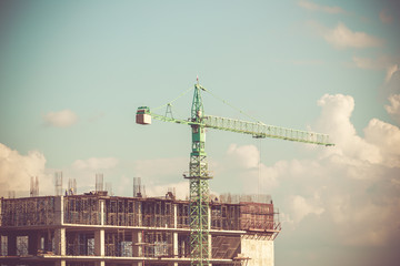 Crane working on construction with retro color tone