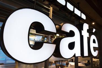 coffee shop logo close up at shopfront
