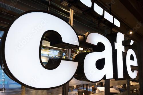 Leinwanddruck Bild coffee shop logo close up at shopfront