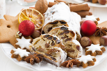 Christmas Stollen with dried fruit, cookies and spices, close-up