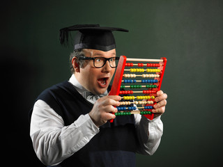 Male nerd with abacus