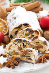 Christmas Stollen with dried fruit, cookies and spices, vertical
