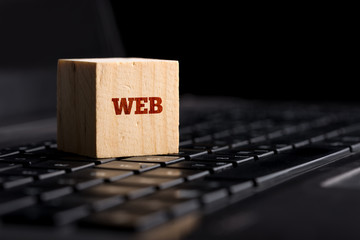 Web on Wooden Block Above Keyboard