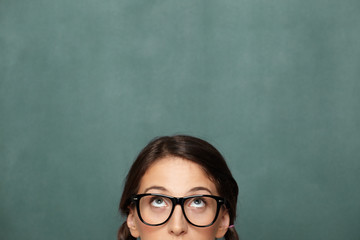 Portrait of young female nerd looking up