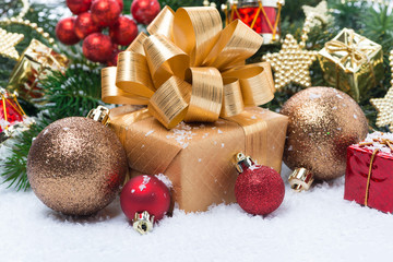 Golden gift box and Christmas tree decorations
