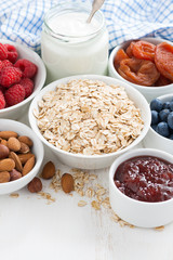 oat flakes and breakfast ingredients, vertical