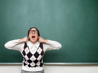 Female nerd yelling in front of the blackboard