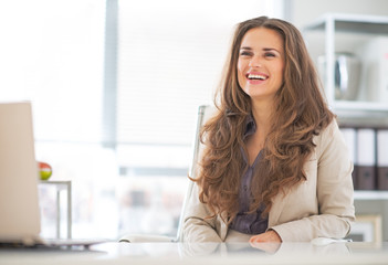 Portrait of happy business woman in modern office