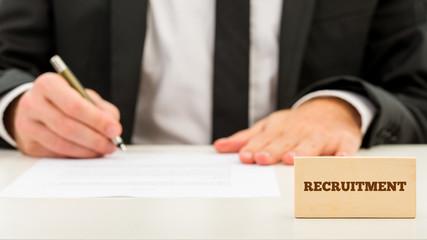 Applicant completing a job application