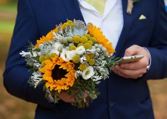 wedding bouquet in the hands of men
