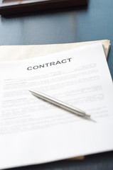 contract papers on wooden desk