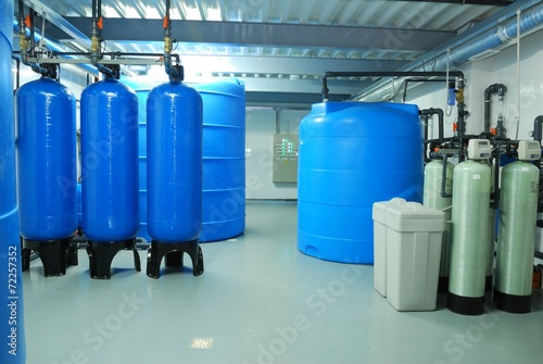 industry pipes, taps, pump and blue barrel - 72257352