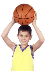 Smiling young boy holding his basketball