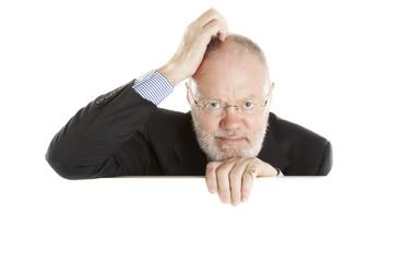 Elderly man behind empty white display
