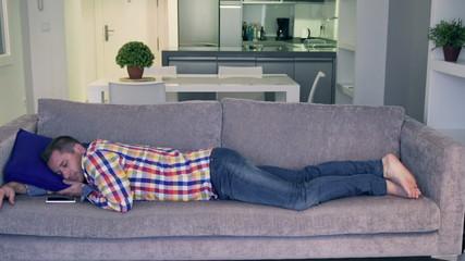 Man sleeping on the sofa at home