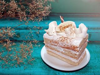Slice of Tiramisu cake in a creative setting