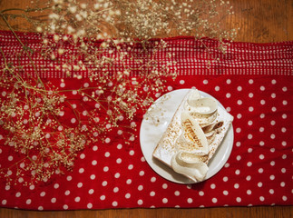 Tiramisu cake on creative background with white polka dots