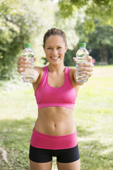 Pretty Fit Woman Holding Bottles of Water