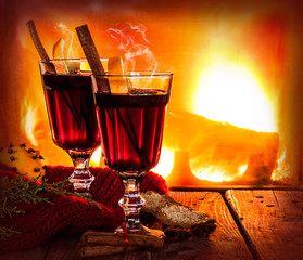Hot mulled wine on fireplace background