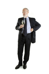 Elderly man with glass of white wine  posing on white