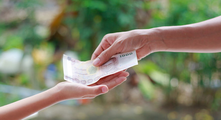 Hand give money to another hand