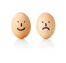 Eggs with painted smileys (smile and sad), smooth and wrinkled