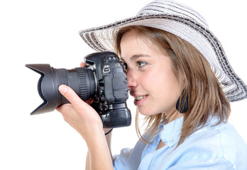 a pretty young girl with a hat takes a picture
