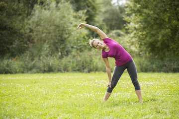 Young woman working out doing aerobics